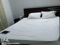 white bed sheet with black wooden bed frame Bengaluru, 560048