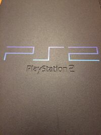black and blue Sony PS2 game console 513 km