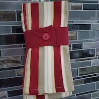 Table mats. 4 in pack. With button tie for storage.