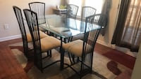7 piece dining set. Glass table top  In good condition. Buford, 30519