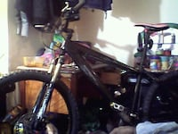 black and red hardtail mountain bike 549 km