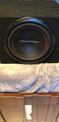 black and red Pioneer subwoofer