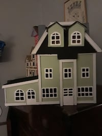 white, green, and black wooden house scale model