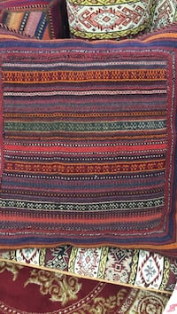 red and multicolored textile