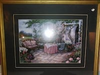 table and couch surrounded by flowers painting with brown wooden frame Russellville, 37860
