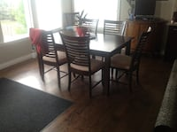 Solid wood canadal table and six chairs with extra leaf from a non-smoking pet free home in very good condition Calgary, T3M