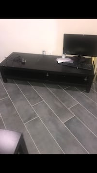 black wooden TV stand with flat screen television Mableton, 30126