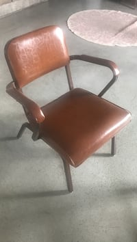 brown leather padded armchair