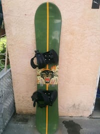 green and black snowboard with bindings South Gate