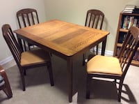 Solid oak dining room table with four chairs  Centre Wellington, N0B 1S0