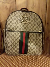 gray and black Gucci leather backpack Savannah, 31404