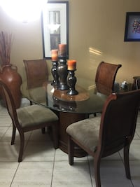 Five piece wood/glass dining room set with lighted open display shelf. Hialeah, 33012