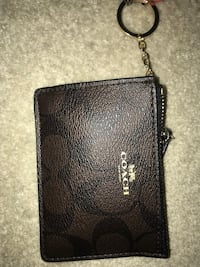 Coach mini wallet with ID&key holder, brand new sealed… pick up close to holdom station or metrotown mall Burnaby, V5C 5A9