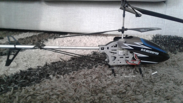 black and gray helicopter toy a4a86e0d-5386-4023-ba09-36cd90306bdf