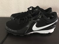 Pair of black nike cleats size 5 1/2 2240 mi
