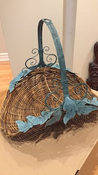 brown woven basket , verdigris handle and leaves Toronto, M6S 2H5