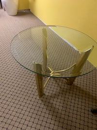 round clear glass-top table with brown wooden base 387 mi