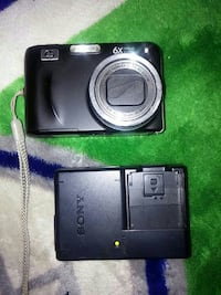 black HP digital camera with Sony battery