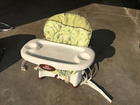 baby's white and green high chair Oshkosh, 54904