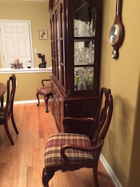 Cherry dining table, 2 side chairs and 4 chairs plus cherry china cabinet.moving sale. Manchester Township, 08759