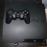 black Sony PS3 Slim with two controllers Toronto, M6N 1C5
