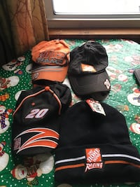 three fitted caps and one black knit hat