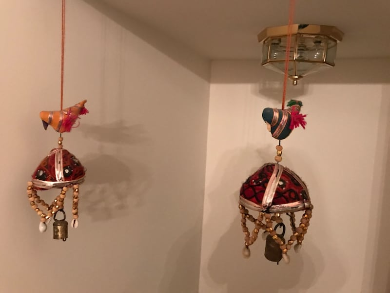 Two red and brown hanging decors d6076955-e67b-4018-a89a-ca3fa3f63686