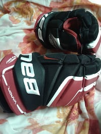 black-and-red Bauer gloves