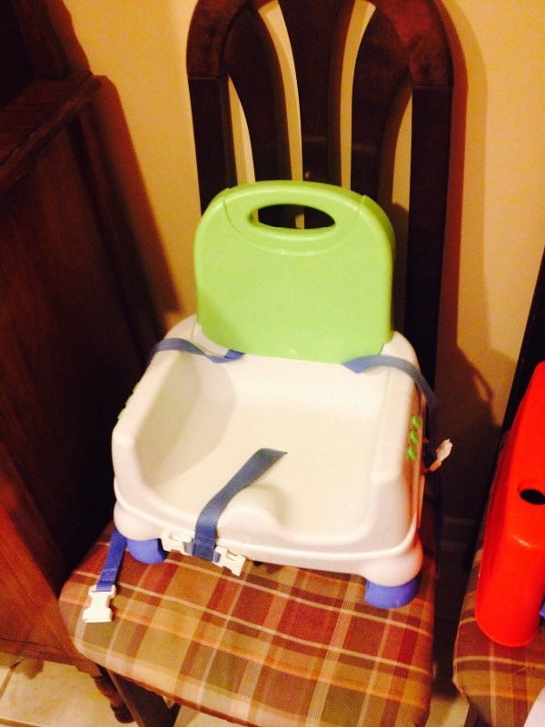 baby's yellow and white high chair