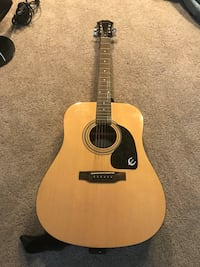 brown and black acoustic guitar  Rockville, 20850