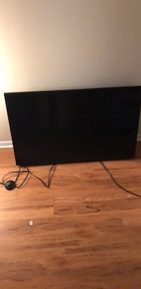 black flat screen TV with remote Woodbridge, 22192