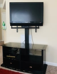 Black flat screen tv with black tv stand Charlotte, 28269