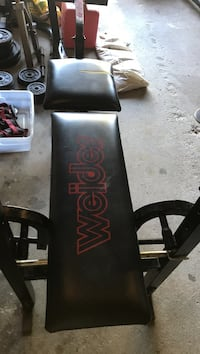 This is an official Joe Weider bench. With Weider weights bars (straight and curl) and hand bars also.  118lbs of Weider weights.  Collars and hand bars included.  Wilmington, 01887