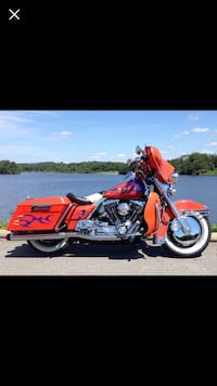 red and black touring motorcycle Lakemore, 44312
