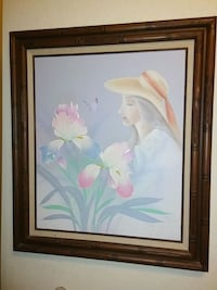 woman near pink iris flowers painting and brown frame Hallandale Beach, 33009