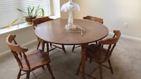 round brown wooden table with four chairs dining set Somerset, 08873