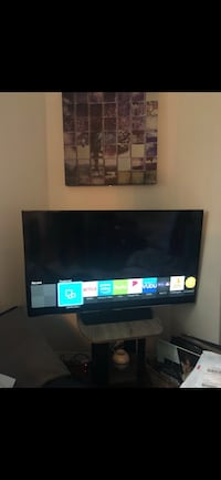 black flat screen TV with remote New York, 10005