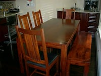 rectangular brown wooden table with six chairs dining set New York