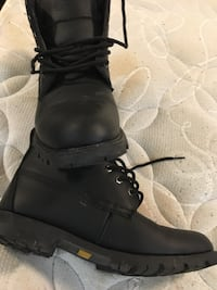 Pair of black leather boots Calgary, T2B 1A8
