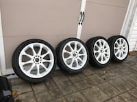 Gray 5-spoke car wheel with tire set 42 km