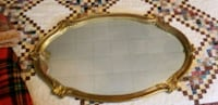 oval brown wooden framed mirror Winchester, 22602