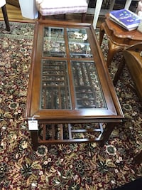 brown wooden framed glass-top center table