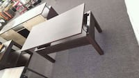 rectangular brown wooden table with chairs Houston, 77092