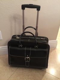 Rolling leather travel bag