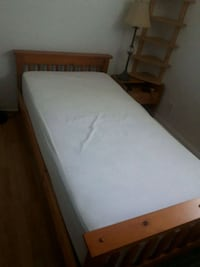 white mattress and brown wooden bed frame Toronto, M6G