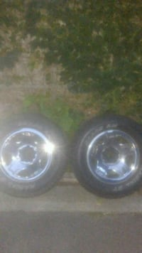 235 60 r15 ford tires and rims.have all 5  Everett