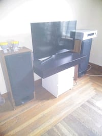 black wooden TV hutch with flat screen television Boston, 02121