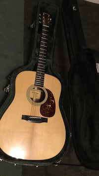 brown acoustic guitar with black case Kelowna, V1W 4A2