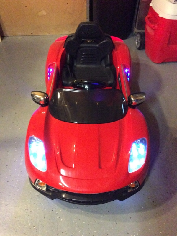 Children's red and black ride on convertible 44f81fb2-817c-4b31-8300-5a5d9b20faf6