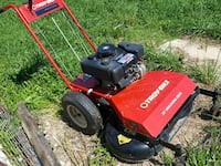 red and black Troy-Bilt Walk Behind (WIDE-CUT) 138 mi